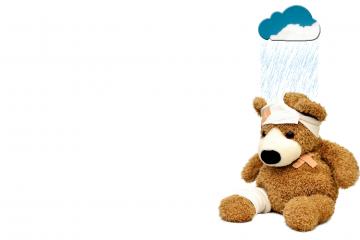 teddybeer onder donderwolk